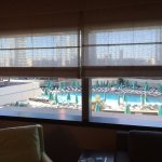 View of pool from 5th floor room. Privacy screen, though no one could see in even when open.