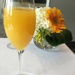 Mimosa and friendly table setting.