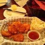 Upper entree is clam strips, lower is coconut prawns. Simple basket presentation.