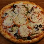 Vegetable pizza- garlic, black olives, green peppers, onion, tomato, mushroom