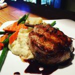 Braised Pork Chop with a Demi glaze sauce Mashed Potatoes and veggies
