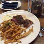 Grilled swordfish; crispy lamb shoulder (best dish); steak-frites (don't bother)
