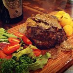 Steak with black truffle and new potatoes