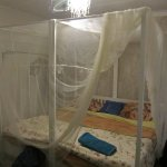 This is the bed with mosquito net in our room