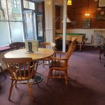Bar billiards table, piano and our big round table seating