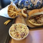 Pulled pork sandwich, slaw, and fires.