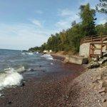 "Shoreline with concrete rubble Worn sofa in #6 ""Nightstand""  in #6"