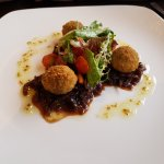 Breaded Vegetarian Haggis Bon Bons served on an Onion and Grain Mustard Relish with Mixed Salad