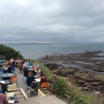 Sitting at Polpeor Cafe on The Lizard