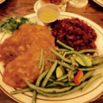 Vegetarisch plate: latkes, red kraut, applesauce, and veggie of the day