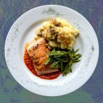 Grilled salmon with green beans and mashed potatoes.