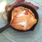 Savory tomato and cheese dutch baby breakfast with applewood bacon and tricolor potatoes