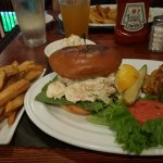Platter with jumbo lump crab cake and shrimp salad sandwich with steak fries and cole slaw