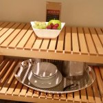 fresh fruit, tray with coffee cups, glasses, wine bottle opener, utensils