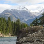 Bow River flowing away from falls towards snowy peaks