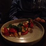 A simple tomato and roasted corn salad made special by its presentation