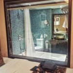 bathroom & bedroom separated by a window with blind. Better for couples rather than friends shar