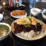 Rice with grilled short ribs, shrimp skewer, fried egg and egg rolls appetizer