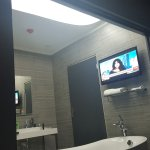 All bathrooms have a TV
