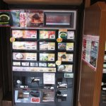 Order outside at the vending machine, take your ticket to the hostess