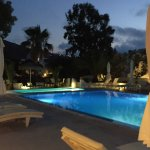 The pool area at night. The dining area is just behind the camera, as is the outdoor bar.
