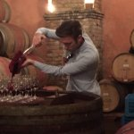 Tammaso pouring wine right from the barrel