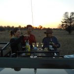 welcoming drinks on the airstrip at sundown