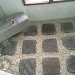 The floor in one of the showers is made up of flatstones and pebbles.