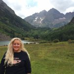 Labor Day weekend, 2016: Me happily posing in front of the Maroon Bells! :)