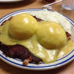 Benedict over Corned beef hash and stone ground grits...