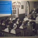 The Faith community: Girls in church (circa 1049)