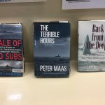books at the display of the timeline of this daring rescue...