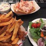 Lobster roll with salad and fries