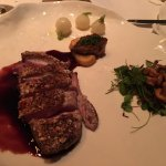 Duck breast encrusted with Jordan almonds and port reduction, very sweet