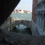 looking out of the bridge of sighs at the tourists,on st marks sq,looking at the bridge of sighs