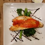 European Sea Bass, seared on skin side, roasted red pepper coulis, broccolini, balsamic reductio