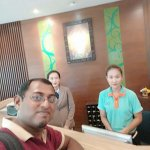 With the front desk staff at the hotel, Ms. Jing