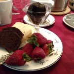Breakfast appetizer of chocolate zucchini bread, yogurt bread, strawberries and chocolate spread