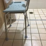Shower chair with inwardly bent leg - far leg is normal angle