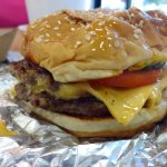 Regular Cheeseburger, tomatoes, pickles, relish, ketchup, mustard