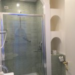 Amazing huge shower with waterfall shower head and standard shower head too