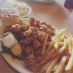 Fried oyster dinner platter with fries and cole slaw