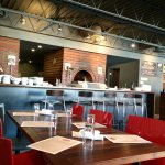 Modern decor - see the brick ovens behind the counter