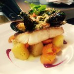 Oven Braised Cod in white wine, with lemon capper butter sauce, On herb mash potato with season