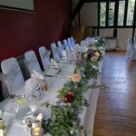 Top table decorated for wedding breakfast