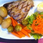 Grilled Tuna steak with seasonal vegetables.