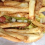 Do you see the hot dog buried under the fries?