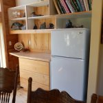 Full size fridge. Small kitchen in through doorway, right side of fridge.