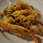 paella with prawns. our waiter brought the whole pan to the table and then served this onto my p