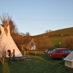 The tipi seen in the glow of the setting sun